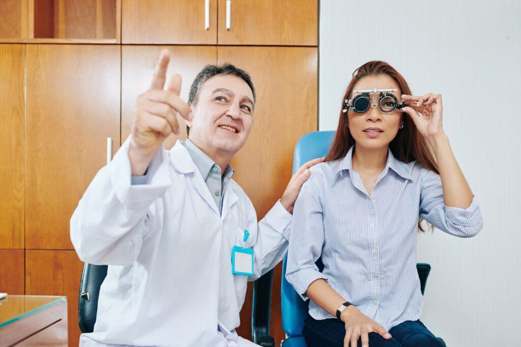 Ophthalmologist testing eyesight of woman