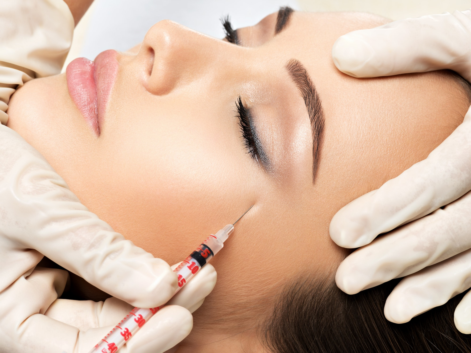 Woman getting cosmetic plastic surgery
